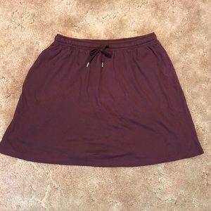 Woman within shirt/short bottom.